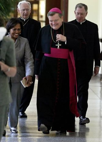 U.S. Archbishop Raymond L. Burke (center) has been prefect of the Supreme Tribunal of the Apostolic Signatura in Rome since 2008. He could be named a cardinal this year. (Associated Press)