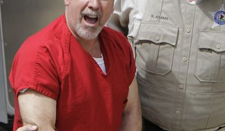 **FILE** In this May 8, 2009 photo, former Bolingbrook, Ill., police sergeant Drew Peterson yells to reporters as he arrives at the Will County Courthouse in Joliet, Ill. (Associated Press)