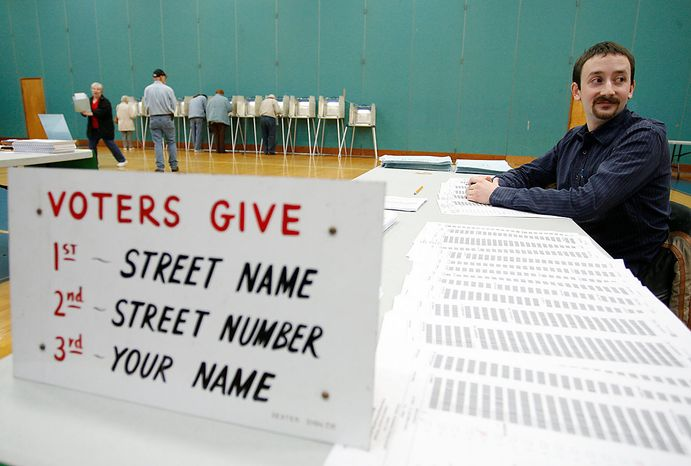 **FILE** James Ostendorf, a pollster, waits to check in Massachusetts voters in a special election to fill the U.S. Senate seat left vacant by the death of Sen. Edward M. Kennedy, in Seekonk, Mass., on Tuesday, Jan. 19, 2010. (AP Photo/Stew Milne)