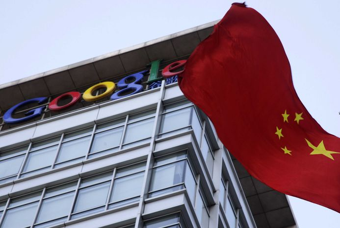 ** FILE ** A Chinese flag flutters outside Google's China headquarters in Beijing on Friday, Jan. 22, 2010. Google closed its China-based search engine last year after complaining of cyberattacks from China against its e-mail service. (AP Photo/Ng Han Guan)