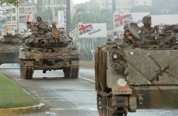 U.S. tanks and armed personal carrier transiting in Panama through the Balboa Avenue, Thursday, Dec. 21, 1989 in Panama City, taking places all over the city to stop the looting and the confrontation between the US troops and forces of Gen. Noriega. (AP Photo/Jaime Fernandez)