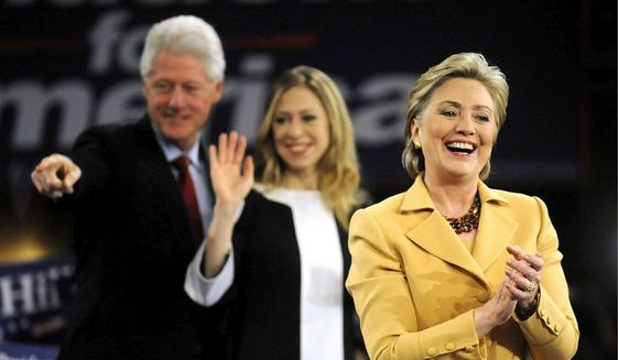 Hillary Rodham Clinton, with husband Bill and daughter Chelsea (The Washington Times) **FILE**