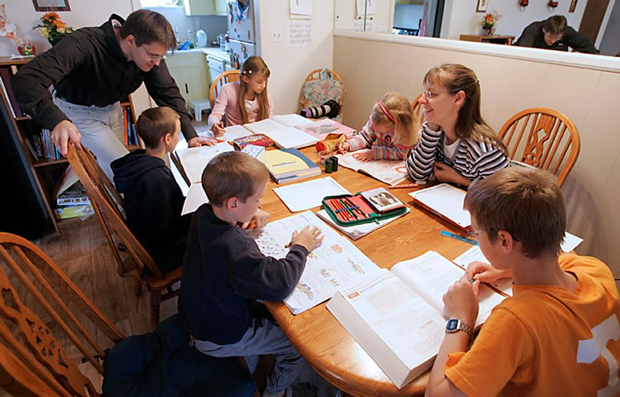 In this March 13, 2009 file photo Uwe Romeike and his wife Hannelore work with their children Daniel (13 yrs.), Lydia (10 yrs.), Josua (9 yrs.), Christian (7 yrs.) and Damaris (3 yrs.) at their home Friday, March 13, 2009 in Morristown, Tenn. The couple had moved into a modest duplex home while they sought political asylum because they say they were persecuted for their religious beliefs by home-schooling their young children in Germany. School attendance is compulsory there and educating children at home is not allowed. The German couple who fled to Tennessee so they could homeschool their children have been granted political asylum by a U.S. immigration judge on Tuesday Jan. 26, 2010. (AP Photo/Wade Payne)