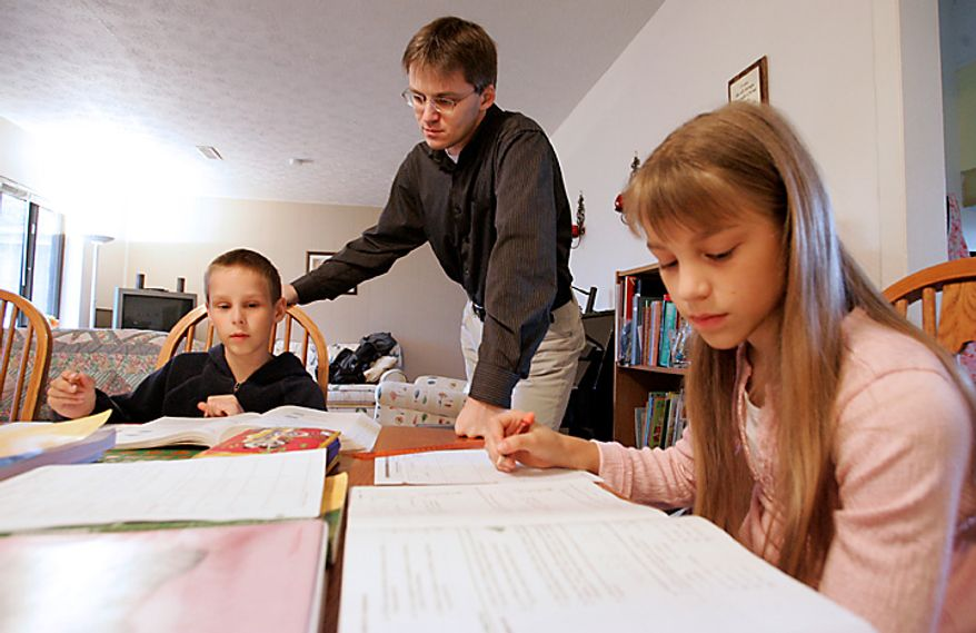 In this March 13, 2009 file photo Uwe Romeike works with two of his children Josua (9 yrs.) and Lydia (10 yrs.) at their home in Morristown, Tenn.  (AP Photo/Wade Payne)