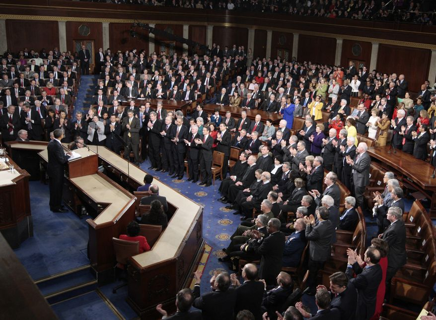 ** FILE ** Democrats stand and Republicans sit as President Obama delivers his State of the Union address on Capitol Hill in Washington on Wednesday, Jan. 27, 2010. (AP Photo/Pablo Martinez Monsivais)