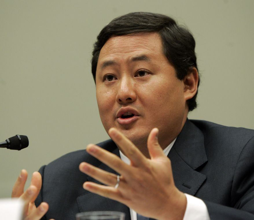 ** FILE ** John Yoo, a law professor at the University of California at Berkeley, testifies on Capitol Hill in Washington on Thursday, June 26, 2008. (AP Photo/Susan Walsh, File)