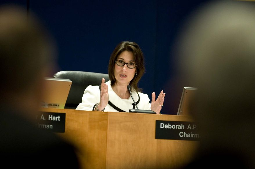 Deborah A.P. Hersman, chairman of the National Transportation Safety Board, presides over a hearing in Washington on Tuesday, Feb. 2, 2010, to discuss the Feb. 12, 2009, crash of Continental Connection Flight 3407 near Buffalo-Niagara International Airport in New York. (AP Photo/Kevin Wolf)