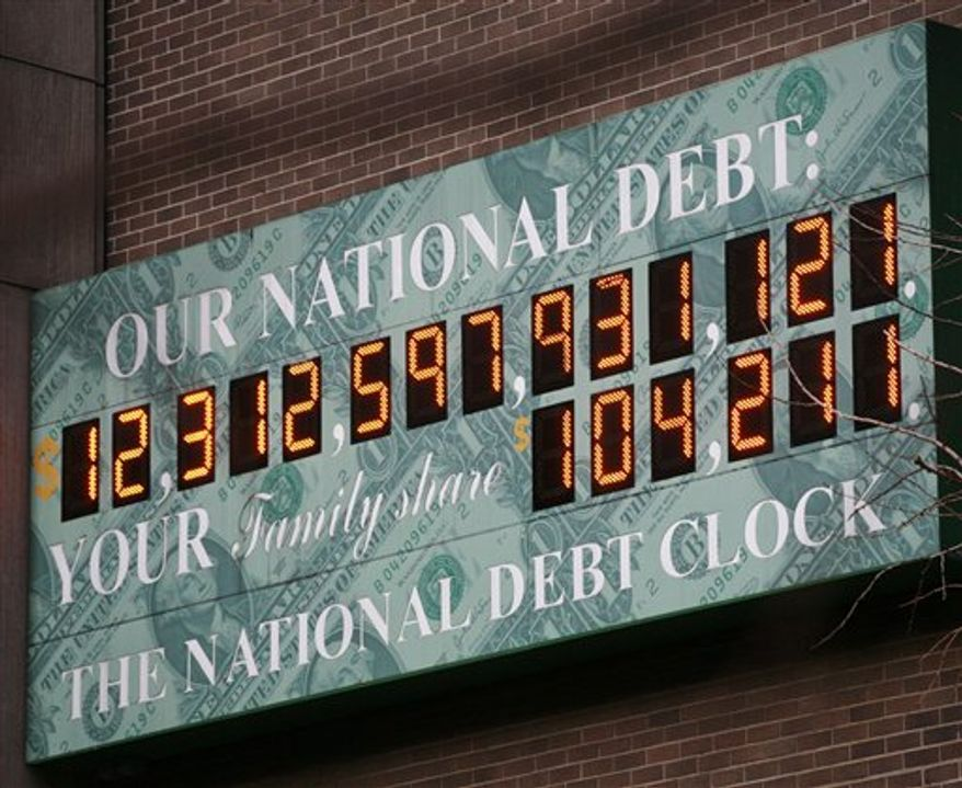 **FILE** The National Debt Clock, a privately funded estimate of the national debt, is shown on Feb. 1, 2010, in New York. (Associated Press)