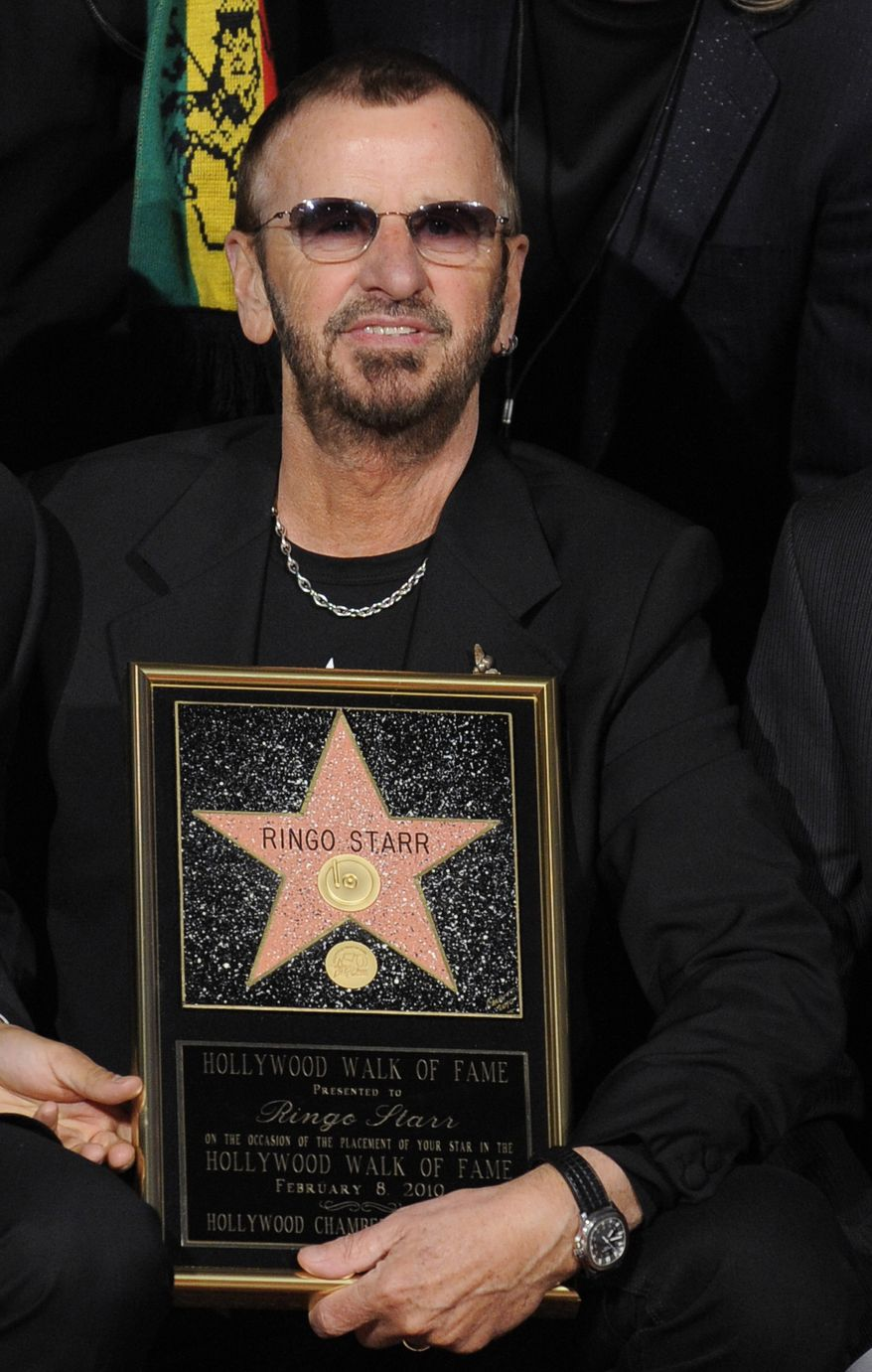 **FILE** Ringo Starr holds a replica of his new star on the Hollywood Walk of Fame during a ceremony in Los Angeles on Feb. 8, 2010. (Associated Press)
