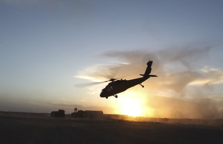 ** FILE ** A U.S. Army Black Hawk helicopter with the Charlie Company, Task Force Talon, takes off at a forward operating base south of Marjah, in Helmand province, southern Afghanistan, Friday Feb. 12, 2010. (AP Photo/Brennan Linsley)