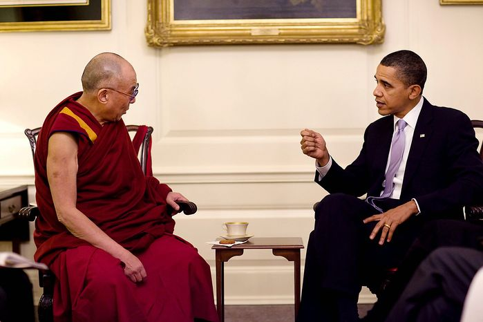 U.S. President Barack Obama (R) meets with His Holiness the Dalai Lama in the Map Room of the White House in Washingt