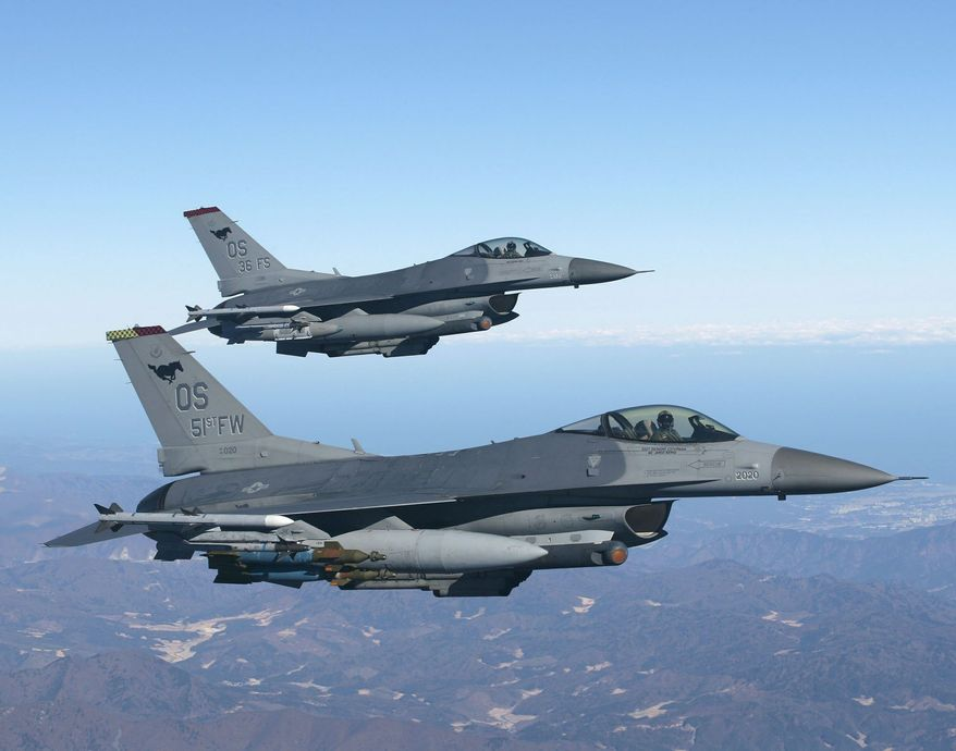 **FILE** Two F-16 jet fighters (Associated Press)
