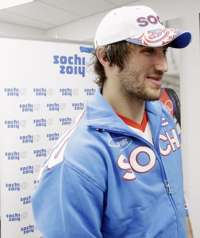 In this Monday, Feb. 22, 2010 file photo, Washington Capitals and Team Russia player Alexander Ovechkin promotes the Russian city of Sochi, site of the next winter Olympic games, during the Vancouver 2010 Olympics in Vancouver, British Columbia. (AP photo)