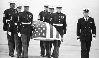 U.S. Marine Corps pallbearers carry the casket holding the body of Mr. Camarena after it arrived at North Island Naval Air Station in San Diego on March 8, 1985. Mr. Camarena is survived by his wife, Mika, and three children, Enrique, Daniel and Erick. He was given a hero's burial at Arlington National Cemetery.