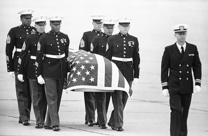 U.S. Marine Corps pallbearers carry the casket holding the body of Mr. Camarena after it arrived at North Island Naval Air Station in San Diego on March 8, 1985. Mr. Camarena is survived by his wife, M