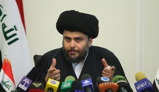 Radical Iraqi cleric Muqtada al-Sadr, speaks in a news conference in Tehran, Iran, Saturday, March 6, 2010. Anti-American cleric Muqtada al-Sadr, in a surprise news conference on the eve of the Iraqi election, has urged his followers to turn out and vote. (AP Photo/Fars News Agency, Hamed Malekpour)