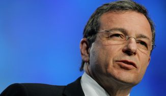 ** FILE ** Bob Iger, president and CEO of the Walt Disney Co., delivers a keynote speech during the TelecomNEXT convention in Las Vegas on March 20, 2006. (AP Photo/Jae C. Hong, File)
