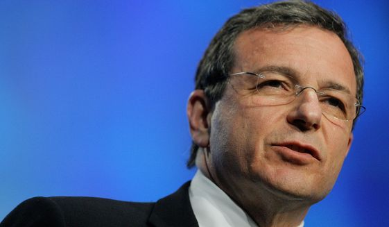 Bob Iger, president and CEO of the Walt Disney Co., delivers a keynote speech during the TelecomNEXT convention in Las Vegas on March 20, 2006. (AP Photo/Jae C. Hong, File)