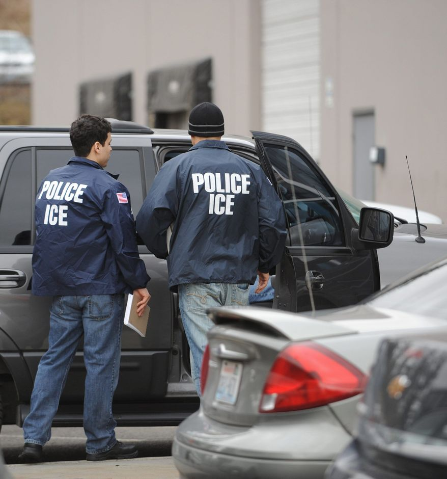** FILE ** U.S. Immigration and Customs Enforcement agents (Associated Press)