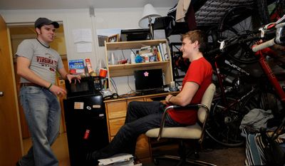 Virginia Tech senior and resident adviser David Dorsett (left) visits with freshman and fellow Lee Hall dorm resident Matt Londrey. (Associated Press)