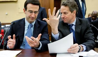 IN THE LINE OF FIRE: Office of Management and Budget chief Peter R. Orszag (left) and Treasury Secretary Timothy F. Geithner confer in March 2010 before testifying to a congressional panel. *FILE PHOTO* (Bloomberg News)