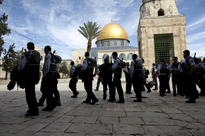 ** FILE ** Israeli police walk through the Al-Aqsa mosque compound, also known to Jews as the Temple Mount, in Jerusalem's Old City on Wednesday, March 17, 2010.