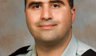 Army Maj. Nidal Hasan, 39, a U.S.-born Army psychiatrist of Palestinian descent, is charged with killing 13 people in a shooting rampage in December on the military post at Fort Hood, Texas. (Associated Press)