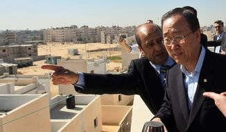 U.N. Secretary-General Ban Ki-moon (right) visits a new house built by the U.N. Relief and Works Agency for Palestine Refugees (UNRWA) for a Palestinian family whose house was destroyed during the Israeli offensive last year. (AP Photo/Mahmud Hams, Pool)