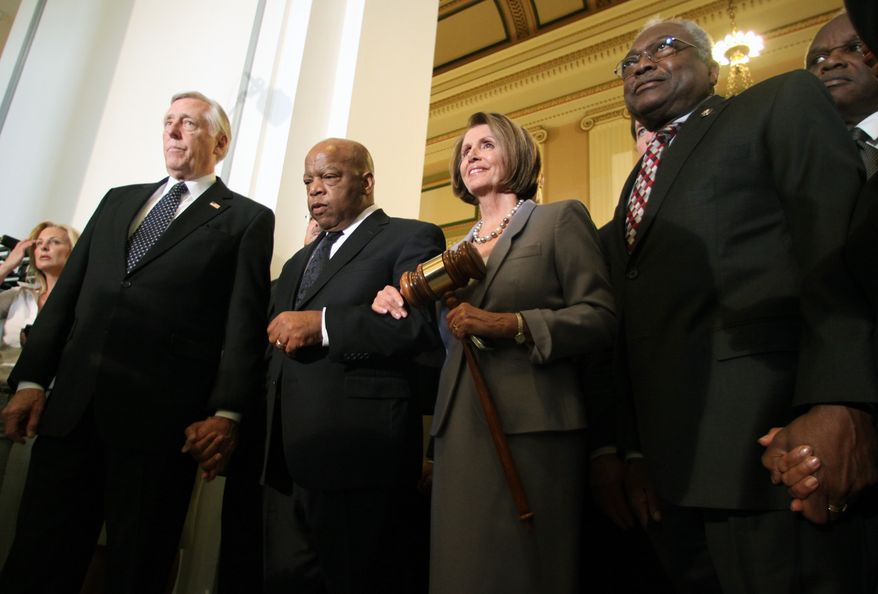 House Speaker Nancy Pelosi holds a large gavel Sunday on Capitol Hill as she emerges from a Democratic Caucus meeting with (from left) Reps. Steny Hoyer, John Lewis and Jim Clyburn. (Associated Press)