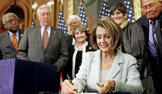 ALL SMILES: House Speaker Nancy Pelosi signs the newly passed health care reform bill Monday as other Democrats wait for souvenir pens. From left are: Majority Whip James E. Clyburn, Majority Leader Steny H. Hoyer, and Reps. George Miller, Louise M. Slaughter, Rosa DeLauro, and John D. Dingell. (Associated Press)
