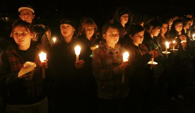 """**FILE** In this photo from Jan. 15, 2010, a candlelight vigil is held at South Hadley High School in Massachusetts for freshman Phoebe Prince, 15, who had killed herself the previous day. Nine teens were charged in the """"unrelenting"""" bullying of Prince, originally from Ireland, who killed herself after being raped and enduring months of torment by classmates in person and online. (Associated Press)"""