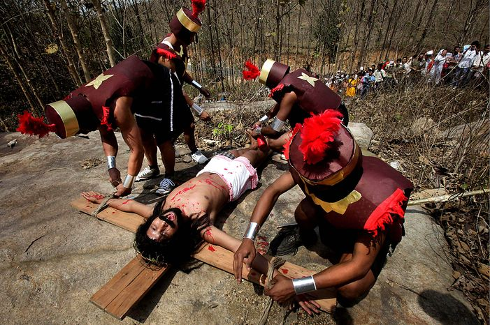 Actors reenact Jesus Christ's crucifixion on Good Friday, in Gauhati, India, Friday, April 2, 2010. Good Friday is observed as a day of mourning in memory of the crucifixion of Christ. (AP Photo/Anupam Nath)