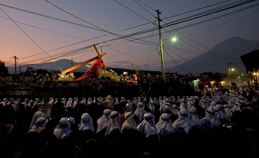People take part in a Good Friday procession in Antigua, Guatemala, on Friday April 2, 2010. Holy Week commemorates the last week of the earthly life of Jesus Christ culminating in his crucifixion on Good Friday and his resurrection on Easter Sunday. (AP Photo/Moises Castillo)
