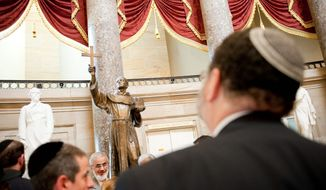 "During a tour of the Capitol in July, rabbis and imams from abroad take time to look at a statue of Father Junipero Serra, a Spanish missionary. The Muslim and Jewish clerics were on an interfaith tour of the United States. ""Here in the United States, there is much more cooperation between Jews and Muslims than in Europe,"" said Rabbi Izhak Dayan, the chief rabbi of Geneva. (The Washington Times)"