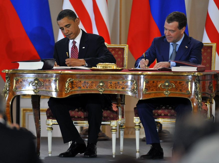 **FILE** President Obama and his Russian counterpart Dmitry Medvedev (right) sign the 'New START' nuclear arms reduction treaty at Prague Castle on April 8, 2010. (Associated Press)