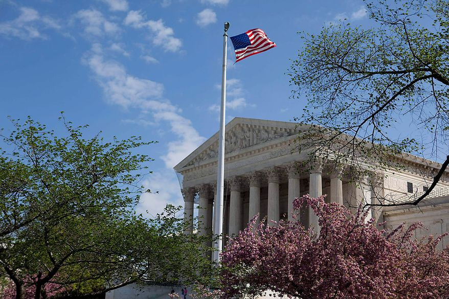 The U.S. Supreme Court building is seen in Washington on Friday, April 9, 2010. (AP Photo/Evan Vucci)