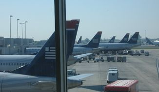 **FILE** US Airways aircraft at the Charlotte Douglas International Airport (Nicholas Kralev/The Washington Times)
