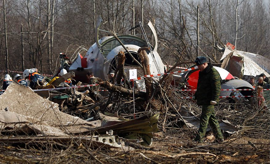 ** FILE ** Investigators work at the site of the Polish presidential plane crash in Smolensk, Russia, on Monday, April 12, 2010. Polish President Lech Kaczynski, his wife, and some of the country's most prominent military and civilian leaders died along with dozens of others when the plane went down as it came in for a landing in thick fog. (AP Photo/Sergey Ponomarev)