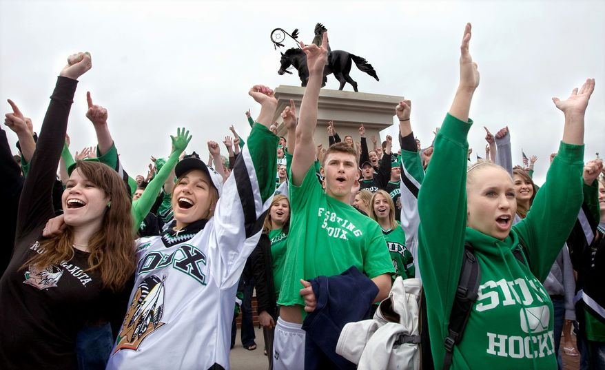 University of North Dakota students and nickname supporters rally on April 9, 2010, at Ralph Engelstad Arena in Grand Forks, N.D. The event was held one day after the North Dakota Board of Higher Education directed the university to begin retiring the Fighting Sioux nickname and logo. (Associated Press)