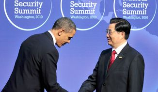 President Obama makes a courtesy bow to welcome Chinese President Hu Jintao to the Nuclear Security Summit in Washington earlier this week. A report by the CIA's Weapons Intelligence, Nonproliferation and Arms Control Center links Chinese companies to nuclear and missile programs in Pakistan and missile programs in Iran. (Bloomberg News)