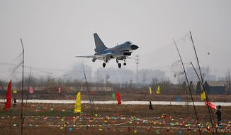 "A Chinese People's Liberation Army Airforce's ""Bayi Aerobatic Unit"" J-10 fighter jet lowers its landing gears during an aerial demonstration at a base of the PLA Airforce's 24th Division in Yangcun, Tianjin, China, Tuesday, April 13, 2010. The media, along with about 51 military attaches from embassies in Beijing, including the United States, Britain and Israel, witnessed a 15-minute demonstration by four pilots from the 24th Air Division in China's domestically developed J-10 fighters. (AP Photo/Alexander F. Yuan)"