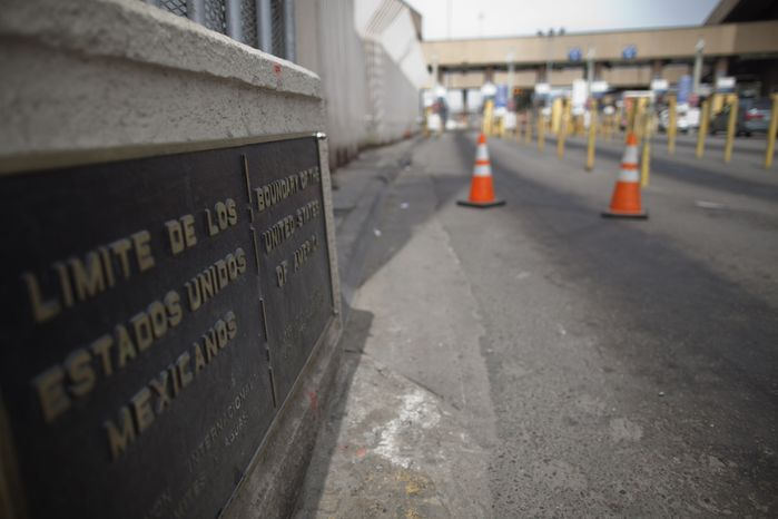 A sign marks Mexico's border with the United States as lanes are closed at the San Ysidro port of entry in Tijuana, Mexico, on Saturday, April 17, 2010. (Associated Pr