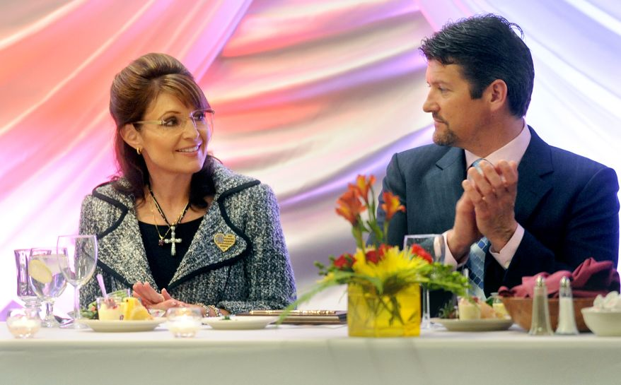 """Former Alaska Gov. Sarah Palin sits with her husband, Todd Palin, during the """"Lessons From Leaders"""" speakers series on Saturday, April 17, 2010, in Washington, Ill. (AP Photo/Journal Star, Adam Gerik)"""
