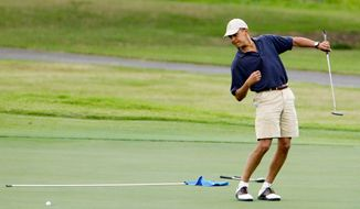 ** FILE ** President Obama shows off his golf form. He took advantage of a canceled trip to Poland to play on In April 2010 at Andrews Air Force Base. (Associated Press)