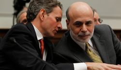 ** FILE ** Treasury Secretary Timothy F. Geithner has a word with Federal Reserve Chairman Ben S. Bernanke as they testify before the House Financial Services Committee on Capitol Hill in Washington on Tuesday, April 20, 2010. (AP Photo/Charles Dharapak)