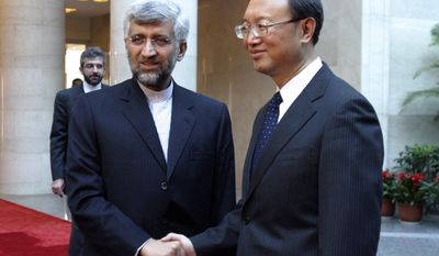 **FILE** Iran's top nuclear negotiator Saeed Jalili (left) shakes hands with Chinese Foreign Minister Yang Jiechi before a meeting on April 1, 2010, at Foreign Ministry in Beijing, China. (Associated Press)