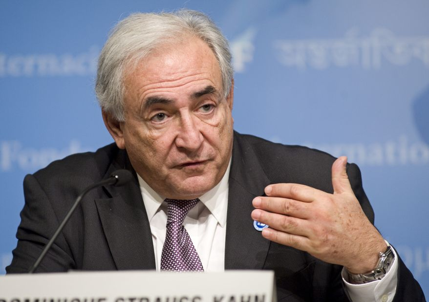 ** FILE ** International Monetary Fund Managing Director Dominique Strauss-Kahn speaks during at a press conference at the end of the second day of the G-20 meeting of finance ministers and central bank governors at the World Bank headquarters in Washington on Saturday, April 24, 2010. (AP Photo/Cliff Owen)