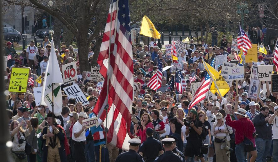 **FILE** In this March 20, 2010 file photo, tea party demonstrators protest outside of the House Chamber on Capitol Hill in Washington. (Associated Press)