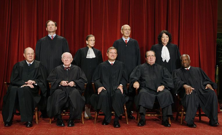** FILE ** In this Sept. 29, 2009, file photo, the Supreme Court poses for a portrait at the Supreme Court in Washington. Seated, from left are: Associate Justice Anthony M. Kennedy, Associate Justice John Paul Stevens, Chief Justice John G. Roberts, Associate Justice Antonin Scalia, and Associate Justice Clarence Thomas. Standing, from left are: Associate Justice Samuel Alito Jr., Associate Justice Ruth Bader Ginsburg, Associate Justice Stephen Breyer