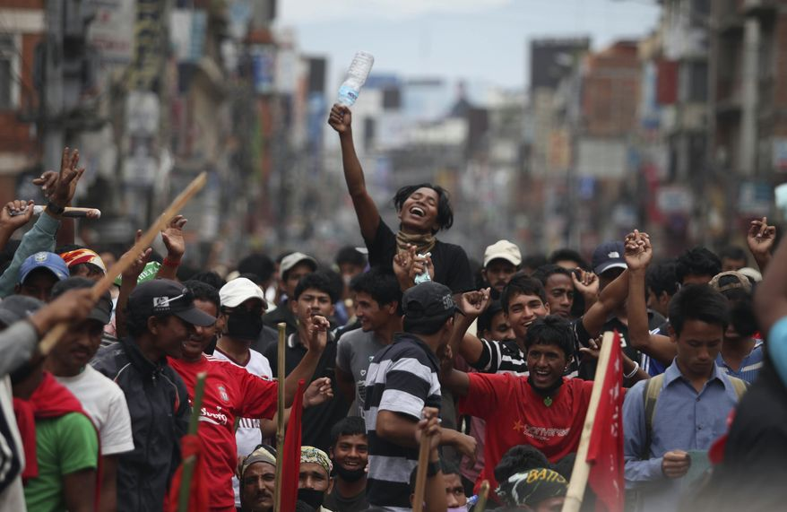 ** FILE ** Supporters of the Communist Party of Nepal, or Maoists, dance to a patriotic song as they block a road in Katmandu, Nepal, on Sunday, May 2, 2010. (AP Photo/Altaf Qadri)
